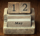 A very old wooden vintage calendar showing the date 12th May on  — Foto de Stock