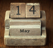 A very old wooden vintage calendar showing the date 14th May on — Stock Photo