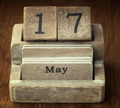 A very old wooden vintage calendar showing the date 17th May on  — Stock Photo
