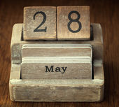 A very old wooden vintage calendar showing the date 28th May on  — Stock Photo