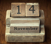 A very old wooden vintage calendar showing the date of 14th Nove — Stock Photo