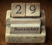 A very old wooden vintage calendar showing the date of 29th Nove — Stock Photo