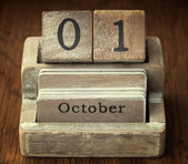 A very old wooden vintage calendar showing the date of 1st Octob — Foto de Stock