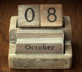 A very old wooden vintage calendar showing the date of 8th Octob — Foto de Stock