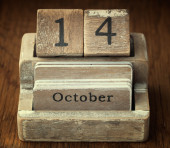 A very old wooden vintage calendar showing the date of 14th Octo — Stock Photo
