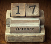 A very old wooden vintage calendar showing the date of 17th Octo — Stock Photo
