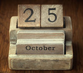 A very old wooden vintage calendar showing the date of 25th Octo — Stock Photo