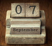 A very old wooden vintage calendar showing the date 7th Septembe — Stock Photo