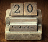 A very old wooden vintage calendar showing the date 20th Septemb — Foto de Stock