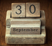 A very old wooden vintage calendar showing the date 30th Septemb — Foto de Stock
