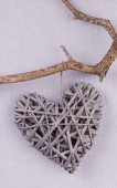 A handmade heart made from twigs hanging on the branch — Photo
