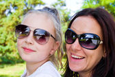 Mother and daughter in sunglasses — Stock Photo