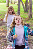 Two eating and playing girls — Stock Photo
