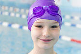 Girl in violet rubber hat — Stock Photo