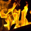 Red fire flame on black background — Stock Photo #79658310