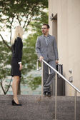 Business partners talking on the stairs — Foto de Stock