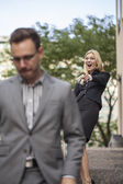 Businesswoman laughing at businessman — Stock Photo