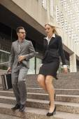 Business partners talking on the go — Stock Photo