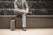 Professional in business attire with suitcase — Stock Photo