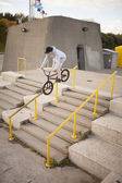 Bmx rider grinding on handrail  — Stockfoto