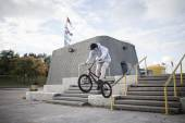 Bmx rider grinding on handrail  — Stock Photo