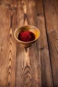 Saffron spice in earthenware bowl — Stock Photo