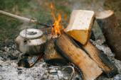 Making tea or coffee in the campfire — Stock Photo
