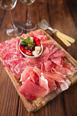 Antipasti Platter of Cured Meat,   jamon, olives, sausage, salam — Stock Photo