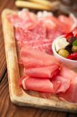 Meat antipasti Platter of Cured Meat,   jamon, olives, sausage,  — Stock Photo
