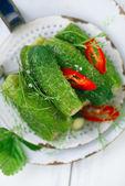 Freshly-salted cucumbers on vintage enamel sieve  — Stok fotoğraf