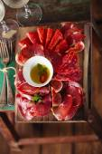Wooden board of Assorted Cured Meats — Stock Photo