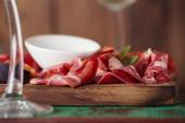 Board of Assorted Cured Meats, olive oil — Stock Photo