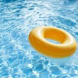 Floating ring on blue water swimpool — Stock Photo #57861241