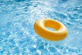 Floating ring on blue water swimpool — Stock Photo