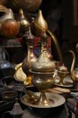 Laps, crafts, souvenirs in street shop — Stock Photo