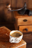 Coffee in vintage cup — Stock Photo