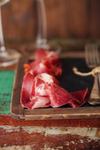 Cured Meat and vintage forks — Stock Photo
