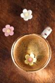 A cup of espresso coffee with sugar flowers — Stock Photo