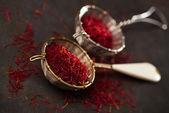 Saffron spice threads and powder — Stock Photo