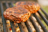 Burgers on bbq barbecue grill — Stock Photo