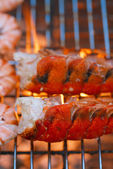 Lobster tails grilled on BBQ — Stock Photo