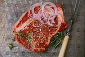 Beef steak t-bone with vintage meat fork — Stock Photo