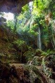 Big, beautiful waterfall in a mountain gorge — Stock Photo