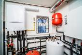 Interior household boiler with gas and electric boilers — Stock Photo