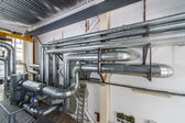 Industrial boiler interior with lots of pipes and valves — Stock Photo