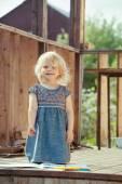 Portrait of a little girl proud of her drawing — Foto de Stock