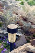 Solar-powered lamp in a garden. Selective focus.  — Stock Photo