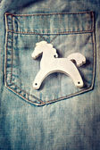 Childs toy wooden horse on jeans pocket, retro styled — Stock Photo