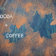 Maple leaves shapes made with cocoa powder — Stock Photo #57489809