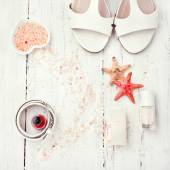 White and coral coloured accessories - sandals, nail polish, bel — Stock Photo